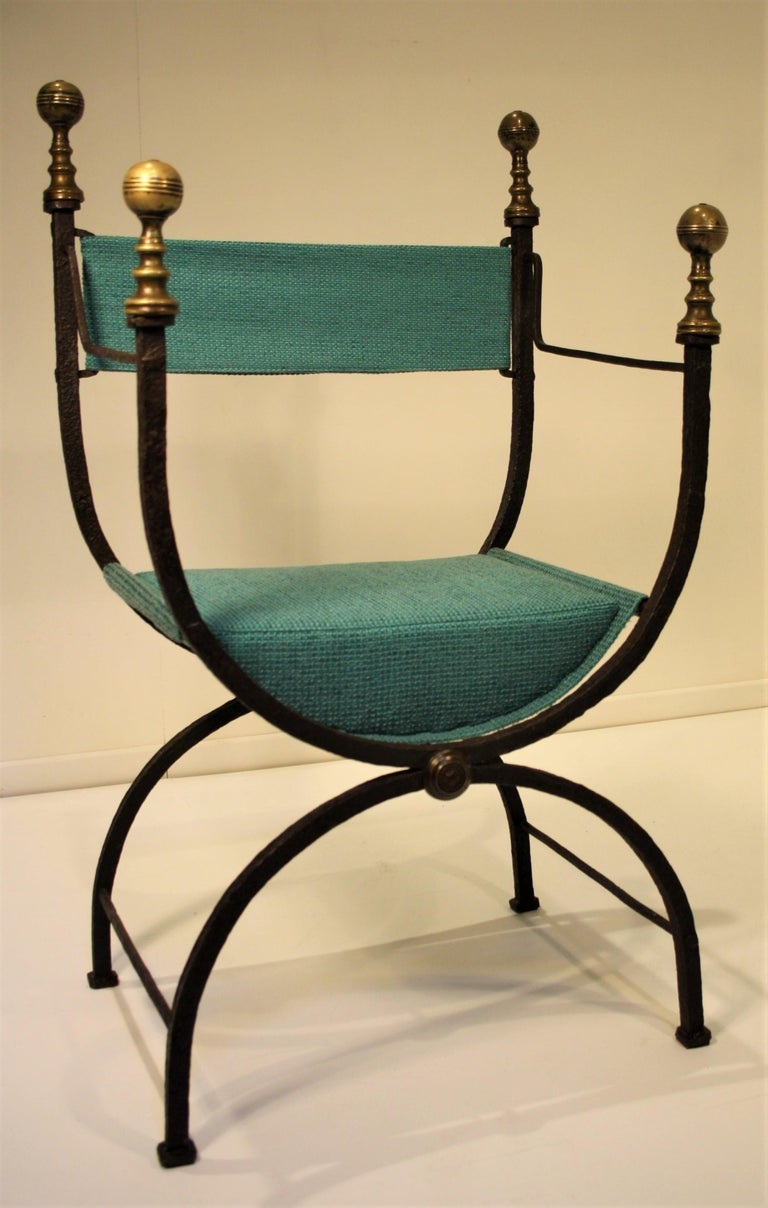 Rare 17th century French Curule chair. The wrought iron has a beautiful original patina, the upholstery has been replaced by a blue turquoise fabric. The metal is distorted by its age and makes the chair even more impressive. This exclusive