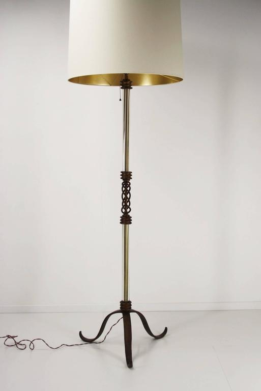 Art Deco floor lamp by Atelier Petitot in gilded wrought iron and glass rods. The lampshade is changed a few years ago but still in very good condition. Total high is 190 cm without shade is 153 cm (60.23 inch). The measures of the shade are: