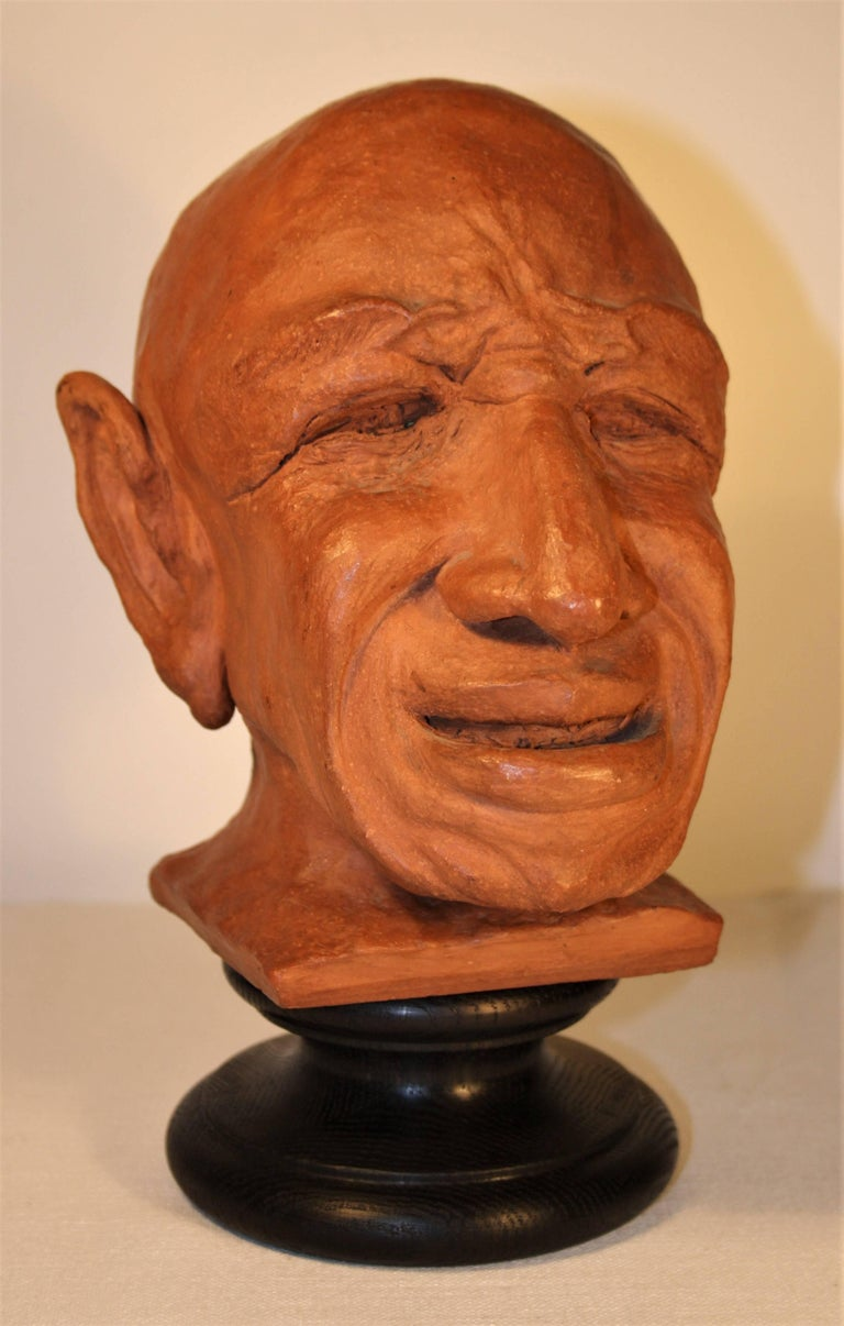 A surprising caricature sculpture in terracotta representing Pablo Picasso from late 1950s-early 1960s, with monogram under the base