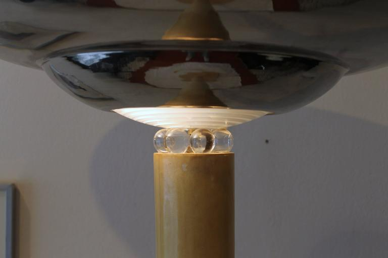Art Deco floor lamp, dated circa 1935. Lambskin upholstered base and shaft. Big chrome metal lampshade with small glass spheres on the base, which reflect the light all around.