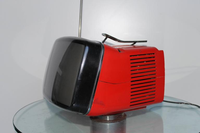 Red Algol 11 portable television by Marco Zanuso and Richard Sapper for Brionvega. A classic of Italian design. It needs some maintenance and a round antenna, but it works!