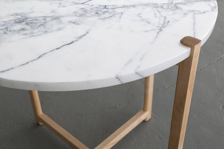 Here the details and connections become the focus at the intersection of surface and structure.  Frame shown in maple and available in ash, white oak, and walnut.  Top shown in white Carrara marble and also available in custom stone and material