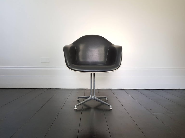 Eames 'La Fonda' chair. Aluminium frame with fibreglass shells and grey leatherette, Herman Miller.