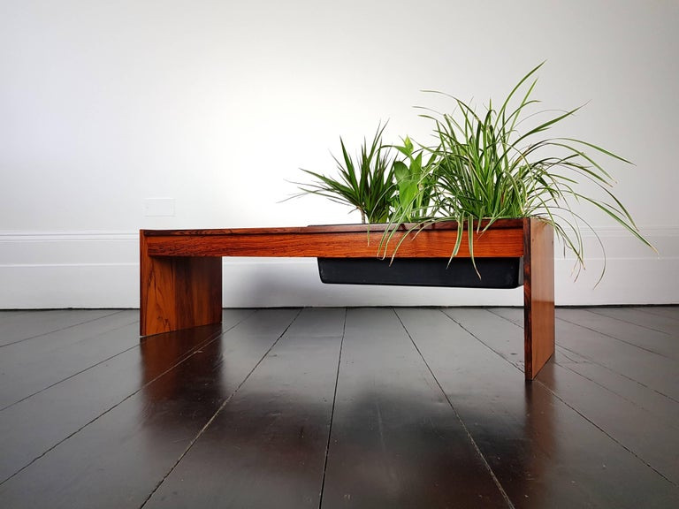 A stunning vintage 1960s Danish planter with rosewood veneer which features impressive grain.