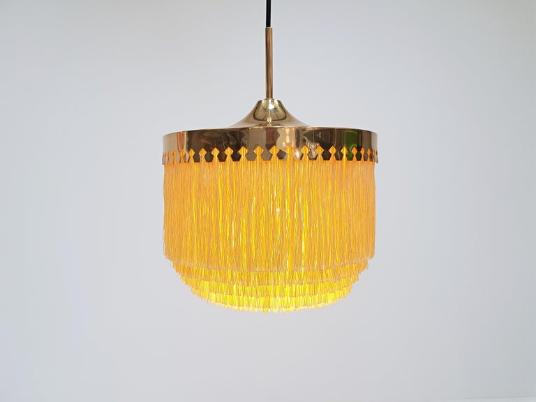 A Hans-Agne Jakobsson for Markaryd brass and ivory silk fringe Model T601/M pendant, 1960s   A Hans-Agne Jakobsson for Markaryd golden-coloured silk fringed pendant with brass frame, dating from the 1960s.  Fully working, rewired, safety tested