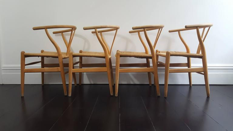 set of four iconic vintage danish hans j wegner ch24 39 wishbone 39 chairs for sale at 1stdibs. Black Bedroom Furniture Sets. Home Design Ideas