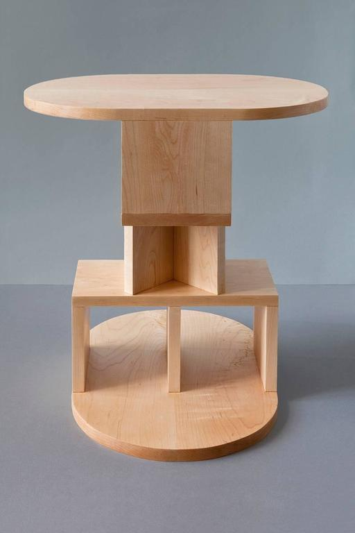 With a playful nod to Postmodern design, the double pyramid table by designer Michael Schoner transforms the side table into a tower-like sculpture with equally balanced proportions. This side table is handcrafted from solid maple in the