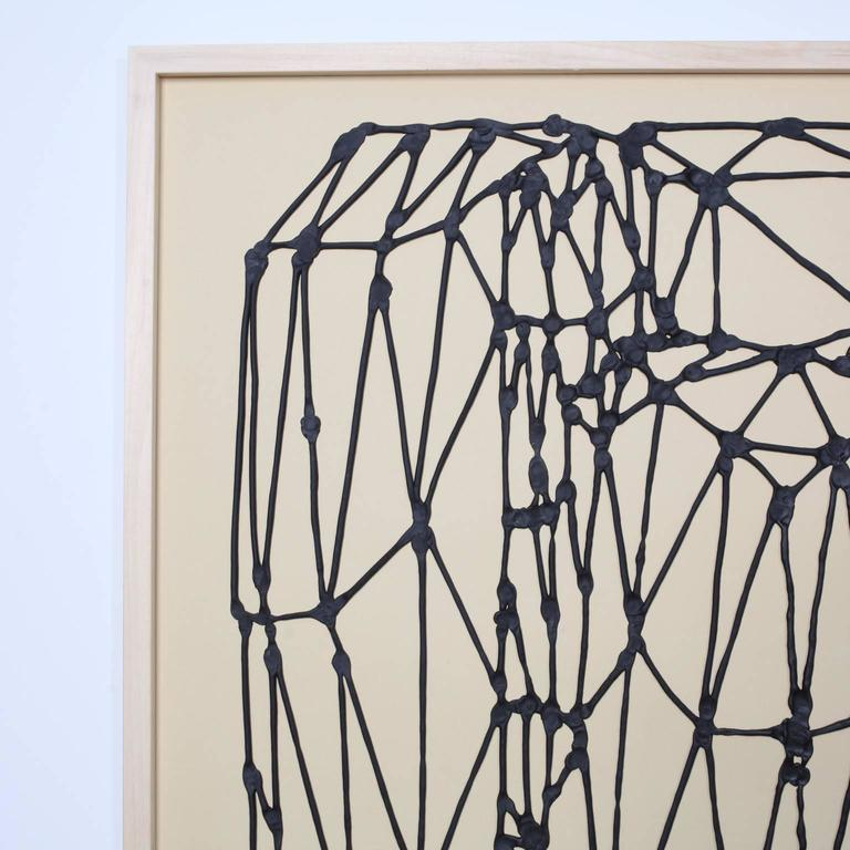 This is a very tactile drawing made from extruded black latex that rises above the surface of the paper. Each intersection of lines has been delicately molded, resulting in irregular traces of the artist's fingerprints. Eric von Robertson's