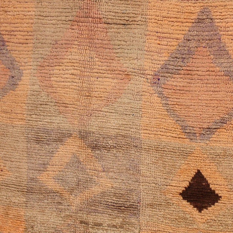 Vintage Rahamna rug with magnificent abrash. This rare handwoven textile from the Rahamna tribe of Morocco transcends everyday life and opens up a metaphysical view on the world around us.   Rahamna carpets are typically either a monochromatic