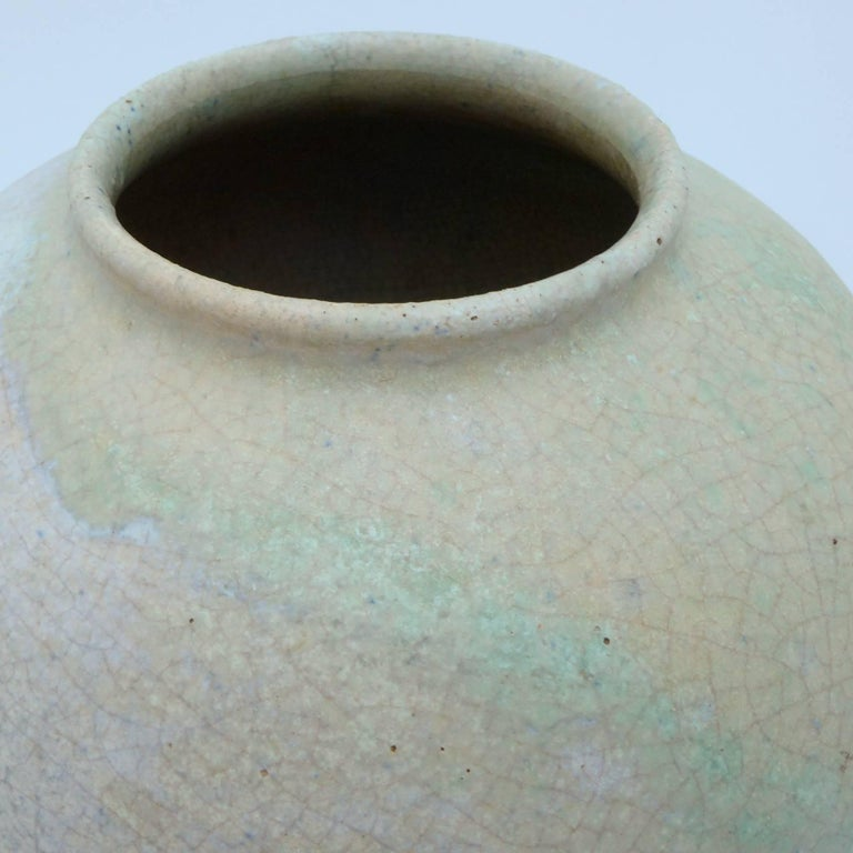 A piece of Dutch pottery history in the form of this beautifully glazed vase by Chris Lanooy (1881-1948). Speckled earthenware vase with green band of streaming glaze.