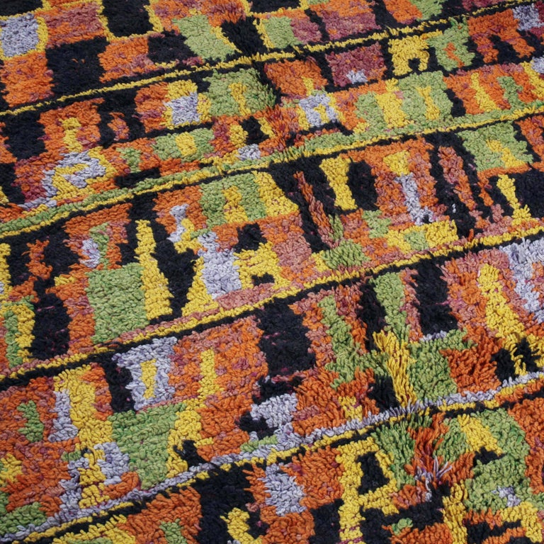 An extraordinary hand-knotted woollen carpet from the Aït Bou Ichaouen tribe.