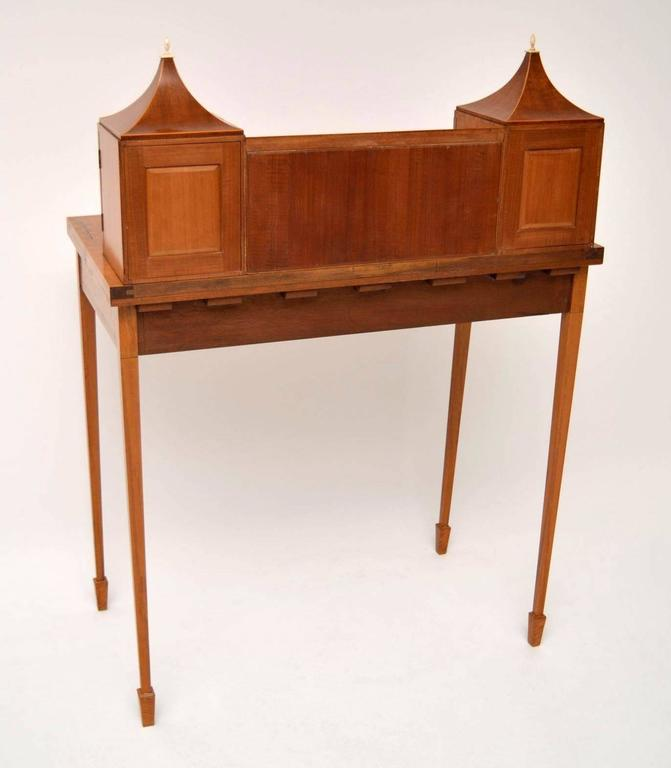 escritoire writing desk Define escritoire escritoire synonyms (furniture) a writing desk with compartments and drawers, concealed by a hinged flap, on a chest of drawers or plain stand.
