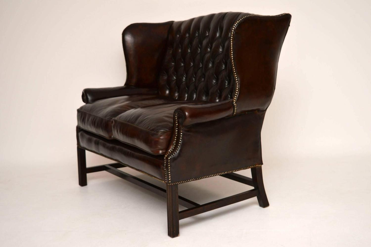 Antique Deep Buttoned Leather Wing Back Sofa For Sale At