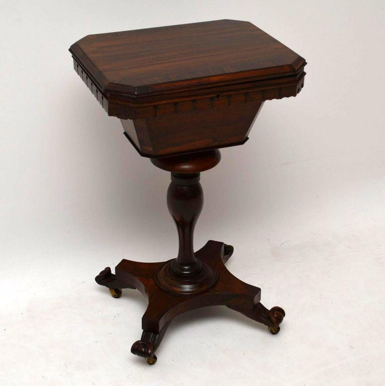 Original William IV rosewood sewing box on stand dating from the 1830s-1840s period and in good condition. The inside has all the original compartments and is lined with old paper, which is in good condition. The top is crossbanded and it has all
