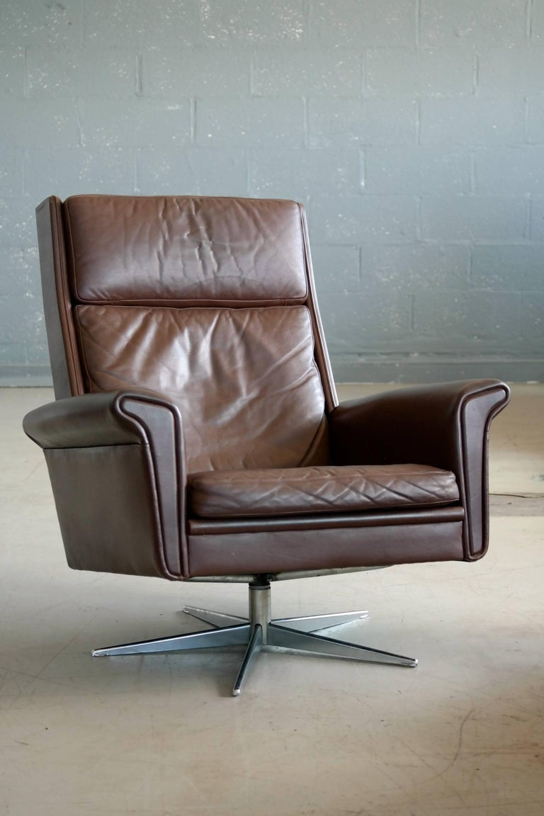 Pair Of Danish High Low Swivel Lounge Chairs In Chocolate