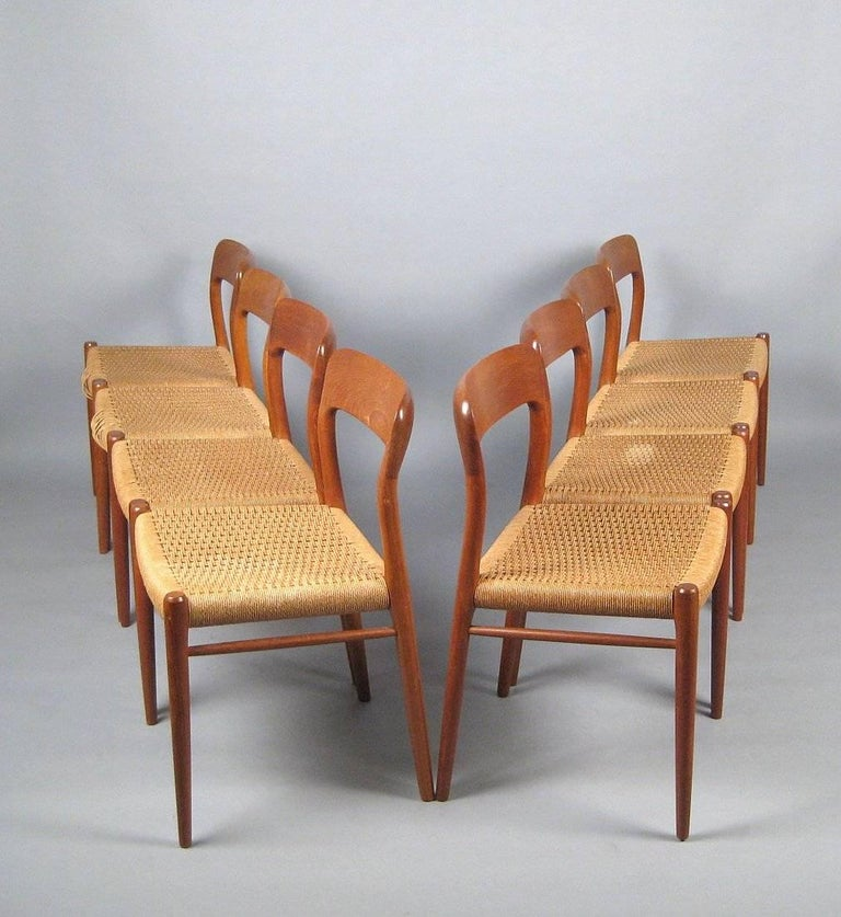 Set of eight dining chairs model 75 - one of the all-time great dining chairs to come out of the midcentury era and as popular as ever. Designed in 1954 by Niels O. Møller for J. L. Møller. Made from solid teak and seats of woven cord. Teak and cord