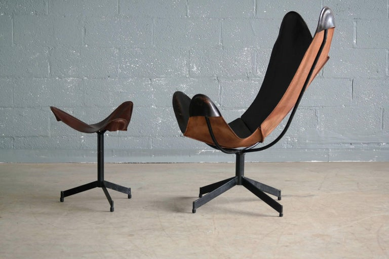 Rare and very sought after 1960s swivel sling chair by William Katavolos for Leathercrafter. Made from forged iron and saddle leather. Great patina and a few minor scuffs and scratches to the leather. Overall excellent condition.