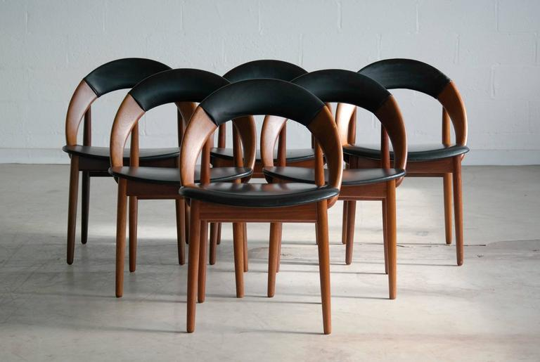 This is a very hard to find set of six iconic dining chairs designed by Arne Hovmand-Olsen. This highly coveted design is often found as a single chair or even in pairs but rarely in full sets. This is the only set offered on 1stdibs currently. The