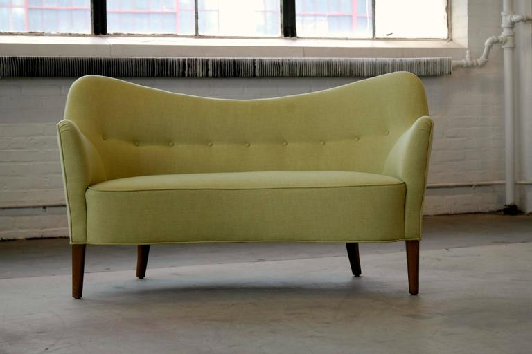 Superbly elegant Finn Juhl attributed petite sofa or settee model 185 made by Slagelse Mobelvaerk, Denmark. The lines and proportions of this design are just perfection. While rare this sofa is often sold as a Finn Juhl model BO-55 designed by Juhl