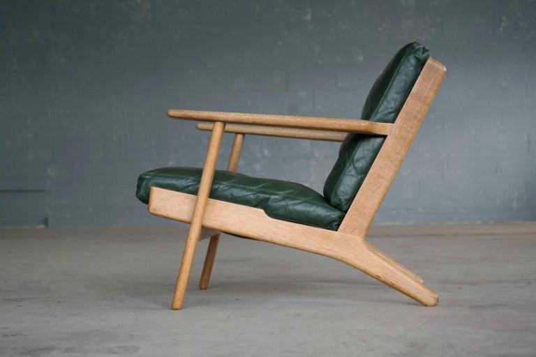 Danish Hans Wegner Low Back Lounge Chair Model GE290 for GETAMA Oak and Green Leather For Sale