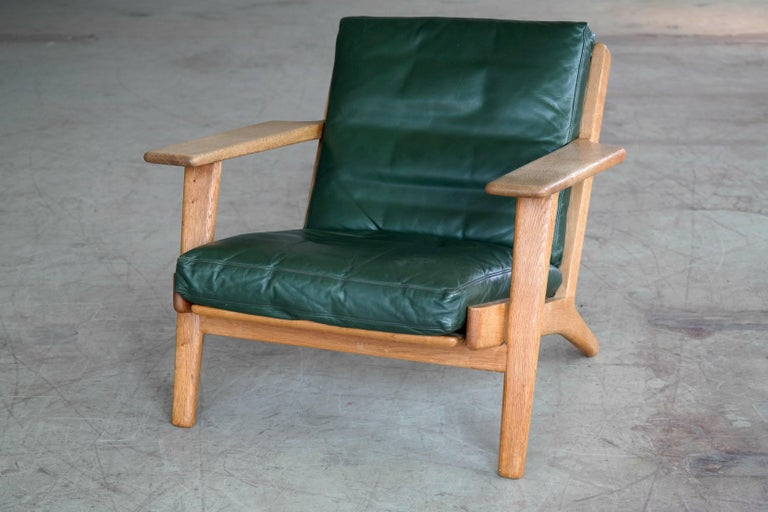 Sought after low back lounge chair model GE290 designed by Hans Wegner for GETAMA in 1953. The GE290 his is one of Wegner's most iconic designs with its solid oak frame, splayed legs and distinctive paddle armrests. This version upholstered in