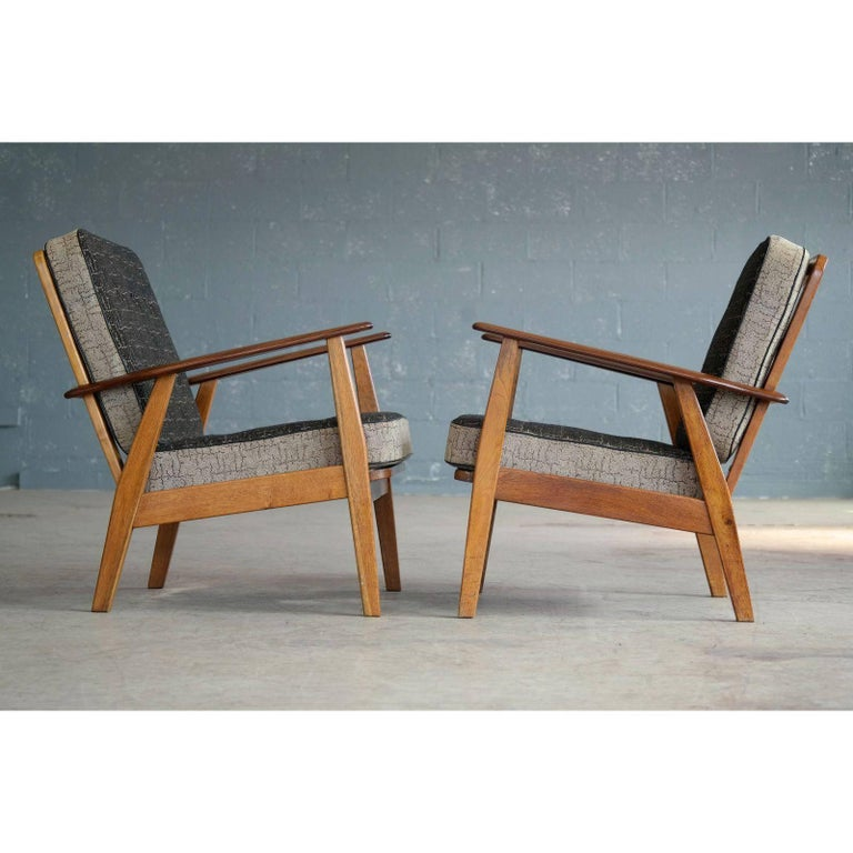 pair of danish hans wegner style midcentury easy chairs in teak for
