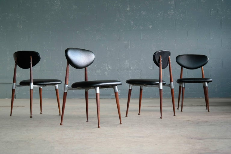 Modern and elegant set of four dining chairs designed in the 1960s by Dan Johnson for Shelby Williams. Manufactured in turned walnut and cast aluminum the chairs offer a very sophisticated almost delicate design expression. Just superb. Excellent