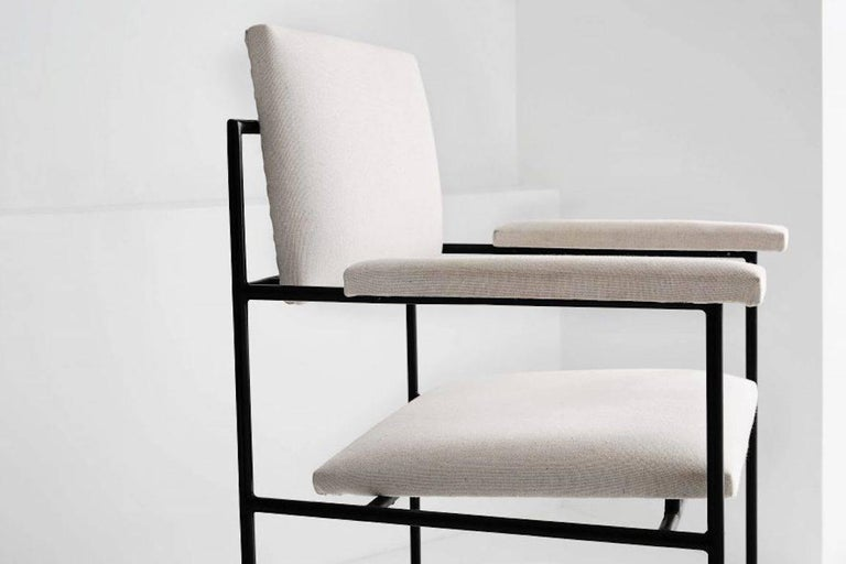 Geraldo De Barros(1923-1998)  Iron single armchair Manufactured by Unilabor Brazil, 1955. Iron frame, fabric upholstered.  Measurements: 55 cm x 65 cm x 75 h cm 21.6 in x 25.59 in x 29.5 H in.  Literature Unilabor, by Mauro Claro.