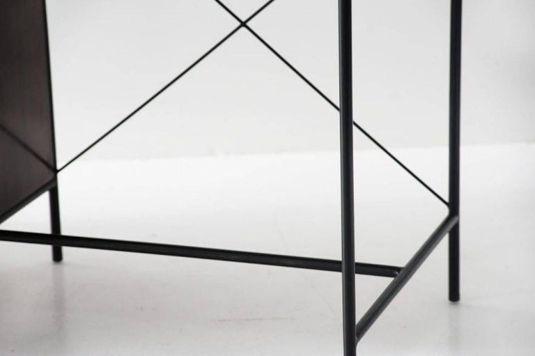 "Geraldo De Barros(1923-1998)  Desk model ""1015"" Manufactured by Unilabor Brasil, 1956 Black painted metal, Formica, jacaranda and brass handles.  Measurements: 150 cm x 53 cm x 75h cm. 59.05 in x 20.83 in x 29.75 H"