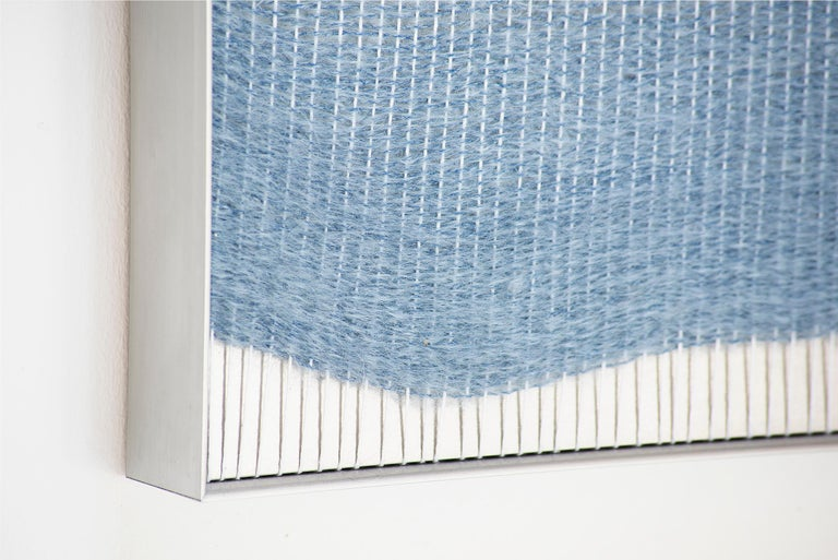 Natural fibers, plywood and aluminum frame. A major theme of Mimi Jung's work is the tension between internal and external experiences, which she typically presents to viewers through interactive, life-sized structures. Her flat woven wall pieces