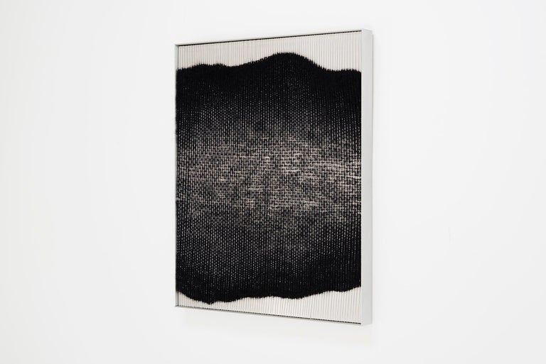 Natural fibers, aluminum sheet and aluminum frame. A major theme of Mimi Jung's work is the tension between internal and external experiences, which she typically presents to viewers through interactive, life-sized structures. Her flat woven wall
