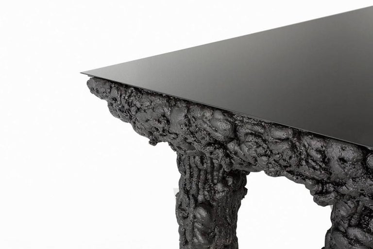 Guillermo Santomá  Black Dining Table  Side gallery edition Manufactured by Guillermo Santomá Barcelona, 2016 Projected polyurethane, wooden structure, glass top  Measurements 320 cm x 90 cm x 78 h cm 126 in x 35,5 in x 30,7 h in.  Details Unique
