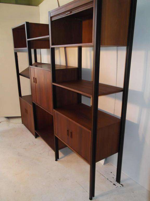 This is a wonderful version of the George Nelson Omni freestanding wall unit. It is super clean with gorgeous grain oiled walnut! It has many cases included. It has the rare stereo cabinet also that has a pull out turntable shelf. Included pcs: Open