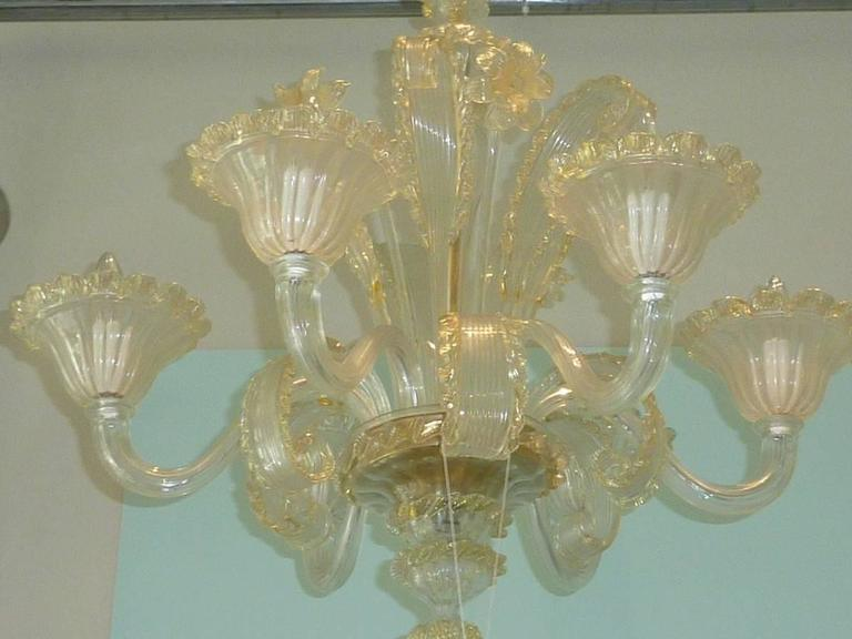 Beautiful big Venetian Chandelier with golden flowers and clear leaves. It has six-lights. This handmade and mouth blown glass item is richly ornamented and stunningly detailed. Chandelier has six European style E14 sockets. It requires six European