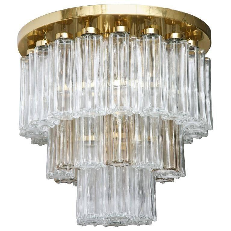 "This unique ""Glashuette Limburg"" three-tier brass and glass 1970s chandelier from Germany contains four electrical sockets designed for European style bulbs."
