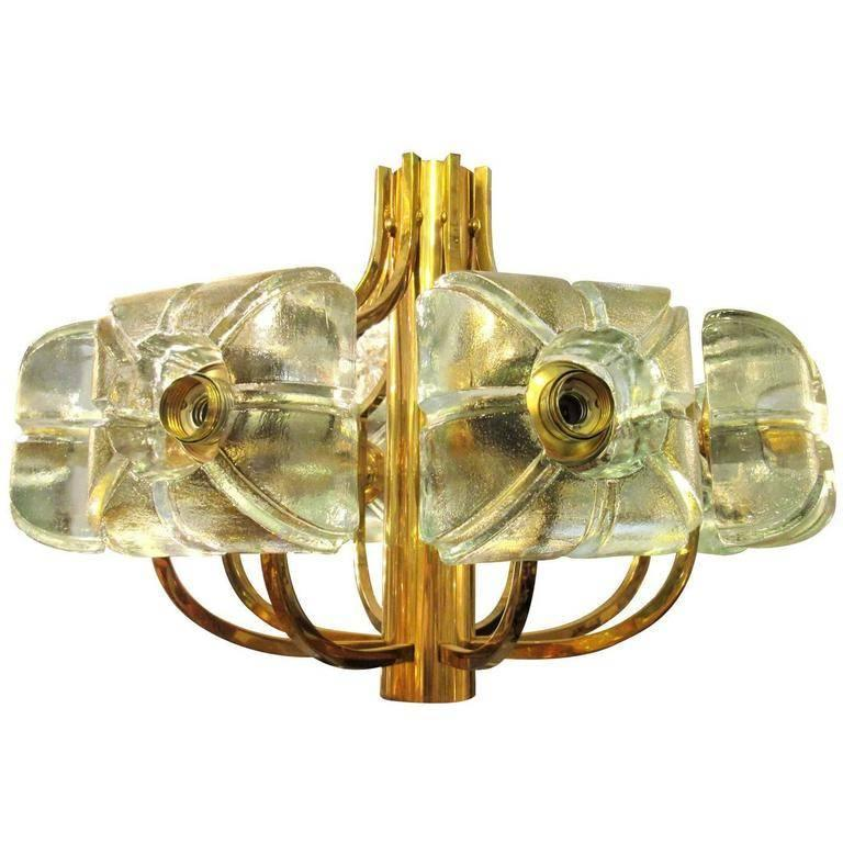 Vintage Kalmar chandelier with brass hardware and thick glass cubes that radiate around the circumference. There are eight sockets in total.
