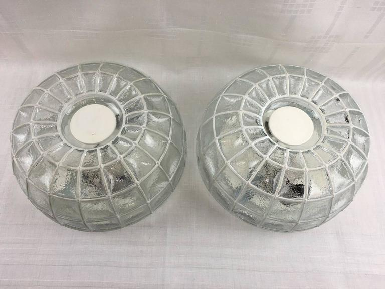 Pair of beautiful glass honeycomb ceiling fixture by Limburg, Germany. This light features a thick clear glass with white grid elements. Takes two E27 base bulbs up to 60 wats per bulb.