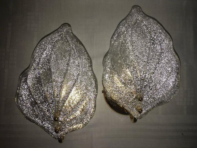 Pair of beautiful sconces made of Murano glass and a gold-plated brass frame, 1960s.  Each fixture requires one European E14 candelabra bulb, each bulb up to 40 watts.