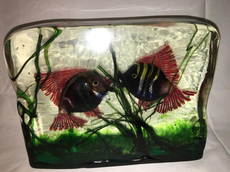 A large Murano glass aquarium in the style of Gino Cenedese. Design attributed to Riccardo Licata. Three dimensional water scene created from three colorless glass panels with polychrome fish and grasses, Italy, circa 1950.