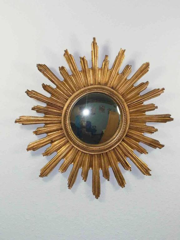 """Gorgeous starburst mirror.  Made of gilded Resin. No chips, no cracks, no repairs. It measures approximate 21 1/4""""; in diameter, Mirror only is approximate 7 1/4""""; in diameter. It stands approximate 1 3/4""""; from the wall to the"""