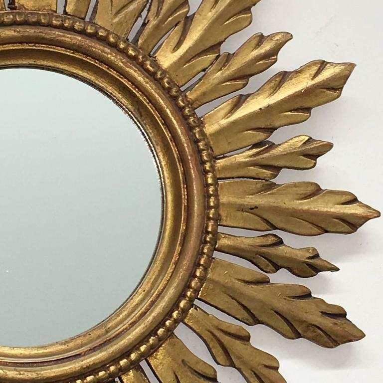 Gorgeous starburst mirror.  Made of gilded wood. No chips, no cracks, no repairs. It measures approx. 19 1/4