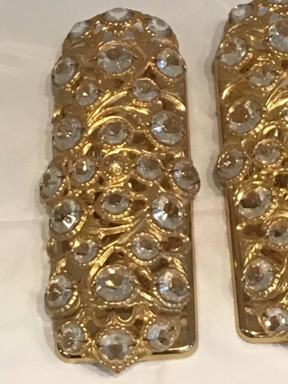 A beautiful pair gilt frame with crystal elements sconces. Made in the 1960s in Italy. Each fixture requires two European E14 candelabra bulbs, each bulb up to 40 watts.