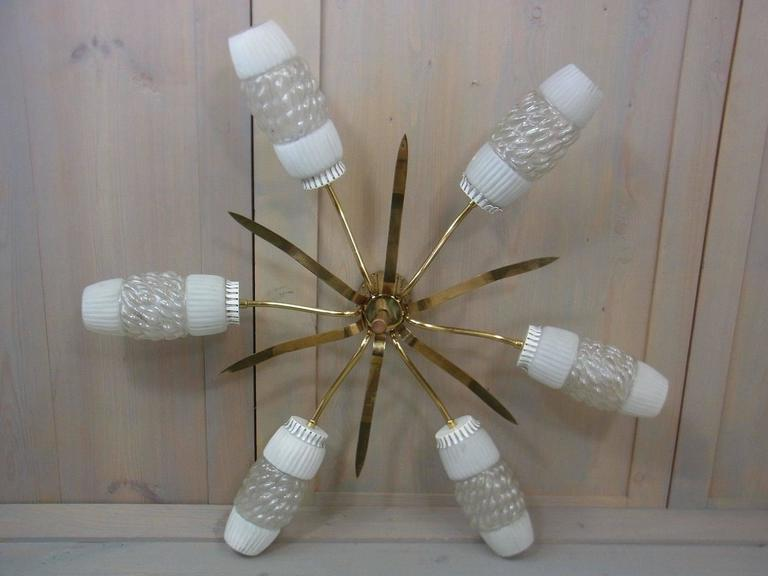 A brass six-arm sputnik flush mount ending with glass shades. Each arm requires one European E14 candelabra bulb, each bulb up to 40 watts.
