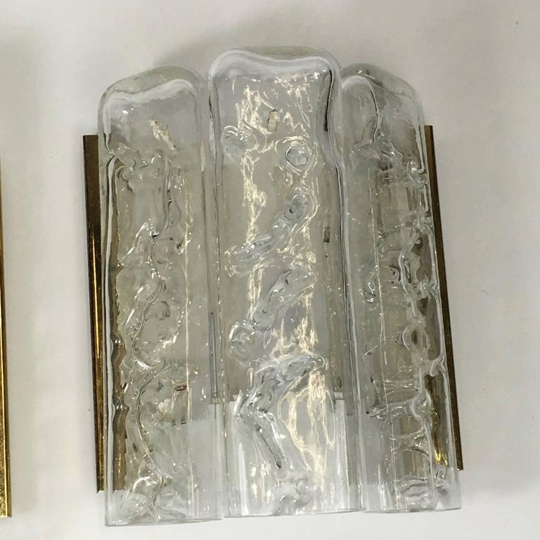 Pair of brass sconces with three ice glass elements. Wall sconces by Doria Leuchten, Germany, mid-1970s. Each sconce takes one European E14 candelabra bulb with max. 40 watt per bulb.