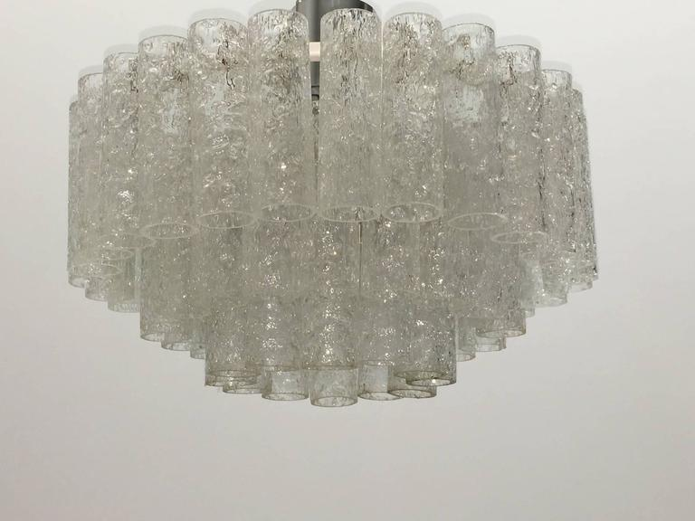 Mid-Century Doria chandelier flush mount, three rings of glass cylinders. The fixture requires six European E14 candelabra bulbs, each bulb up to 40 watts and one E27 Edison bulb up to 75 watt.