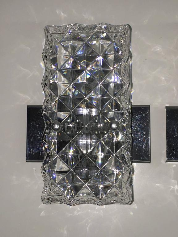 A pair of 1970s sconces, with rectangular glass. Each fixture requires one European E14 candelabra bulb, each bulb up to 60 watts.