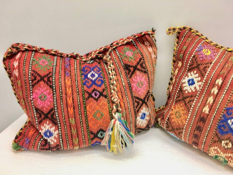 Gorgeous pair of oriental pillows. Handmade of woolen salt bags or oriental rug. Each measures approximate 13.25 inch high, is approximate 18.75 at the widest point and about 5 inch deep.