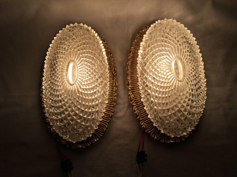 One Great Pair of Textured Glass and Surrounded Gilded Brass Limburg Sconces In Good Condition For Sale In Frisco, TX