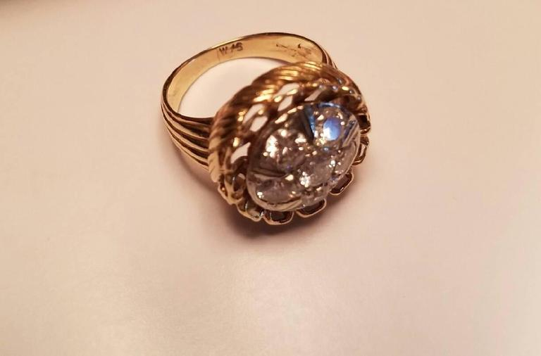 Sized 5 ½ ladies 14-karat yellow gold diamond dinner ring. Ring has a round cluster top in 14-karat white gold. It has a six diamond cluster. There are 5.15 pts round diamonds and 1.25 pts round diamond. Total weight of diamonds is 1.15 pts.