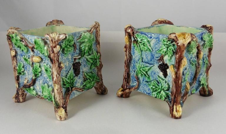 19th pair of Palissy squares jardinieres, two sides with oak leaves and acorns, two sides with grapes signed Thomas Sergent. Thomas Victor Sergent was an active member of the School of Paris with others ceramists he made platters and other several